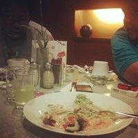Photo taken at Mezza Cafe Aston Rasuna by dewi a. on 6/15/2013