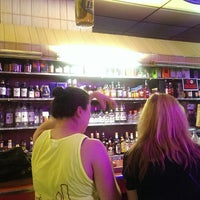 Photo taken at Ola's Liquors by kristina on 7/13/2014