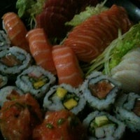 Photo taken at Sushi Nakay by Bruna C. on 12/8/2012