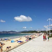 Photo taken at Praia de Samil by Daniel R. on 8/3/2013