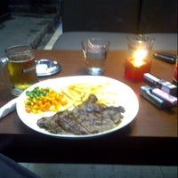 Photo taken at Daisy's Steak and Grill by Eikichy A. on 12/8/2012