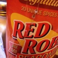 Photo taken at Red Robin Gourmet Burgers by Ashley C. on 4/4/2013