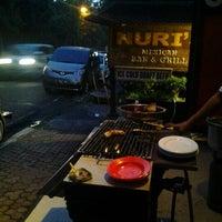 Photo taken at Naughty Nuri's Warung by Irene H. on 12/24/2012