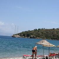 Photo taken at Yeşim Beach & Restaurant by Naz G. on 6/12/2013