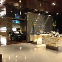 Photo taken at SIA SilverKris Lounge (Terminal 3) by Richard Y. on 6/10/2013