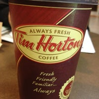 Photo taken at Tim Hortons by Manny V. on 10/27/2012