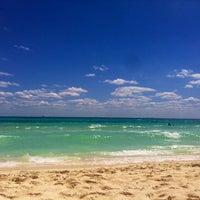 Photo taken at Playa Xaman-Ha by Pris d. on 3/5/2013