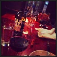Photo taken at The Tangled Vine Wine Bar & Kitchen by Sara P. on 4/29/2013