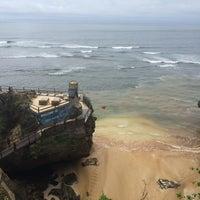 Photo taken at Suluban Beach by Nacho M. on 12/3/2014