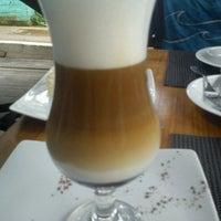 Photo taken at Cacahuá Chocolateria & Café by Nita B. on 4/6/2013