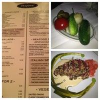 Photo taken at Majors Steak House by Caroline K. on 7/19/2013