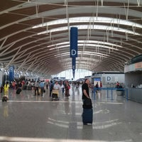 Photo taken at T2 Shanghai Pudong Int'l Airport by Vladislav P. on 8/7/2013