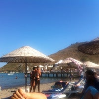 Photo taken at Parıltı Beach by Tolga D. on 7/22/2014