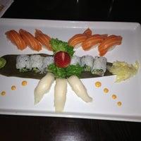 Photo taken at Umami Sushi by Alex C. on 4/13/2013