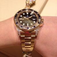 Photo taken at Rolex by Sasha K. on 10/30/2012