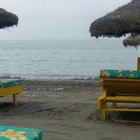 Photo taken at Playa Ferrara by Fernando A. on 8/4/2013