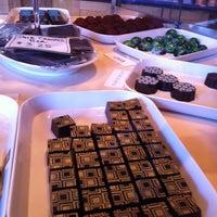 Photo taken at BLU Boy Chocolate Cafe and Cakery by Namrata on 3/23/2013
