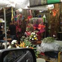 Photo taken at Dangwa Flower Market by Mc M. on 9/16/2012