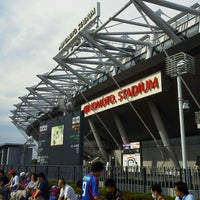 Photo taken at Ajinomoto Stadium by Kumiko T. on 7/6/2013