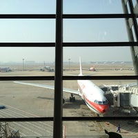 Photo taken at T1 Shanghai Pudong Int'l Airport by Timur R. on 12/24/2012