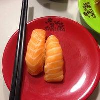Photo taken at Sakura Sushi Train by Eugene P. on 6/28/2014