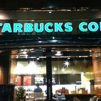 Photo taken at Starbucks by kazuki01 on 12/23/2012