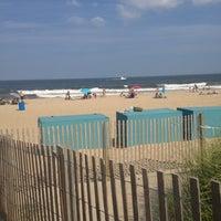 Photo taken at Ocean City Beach by Jamila R. on 7/20/2013