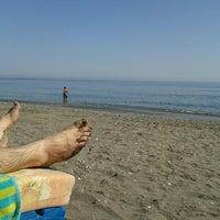Photo taken at Playa Ferrara by MJU on 6/15/2013