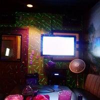 Photo taken at Karaoke Hut Sports Bar & Grill by James C. on 4/20/2013