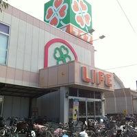 Photo taken at ライフ 向日店 by Kazuya T. on 10/3/2012