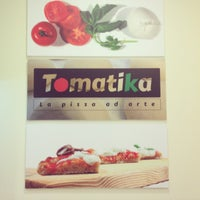 Photo taken at Tomatika by Cristina A. on 3/28/2013