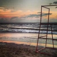 Photo taken at Playa de San Clemente del Tuyú by Lucas A. on 1/11/2014