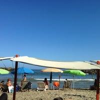 Photo taken at Playa Marina Grande by Anthony P. on 1/27/2013
