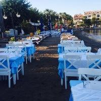 Photo taken at Tuna Restaurant by Ebru on 8/28/2015
