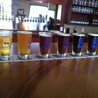 Photo taken at Blue Stallion Brewing Co. by Olivia B. on 7/23/2013