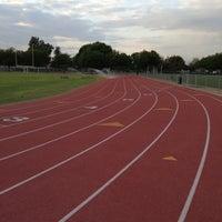 Photo taken at Santa Fe High School Track by Tess C. on 5/8/2013