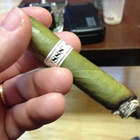 Photo taken at Empire Cigars by Matthew C. on 4/5/2013
