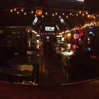 Photo taken at Grimm's Sports Bar & Grill by Adam T. on 1/18/2013