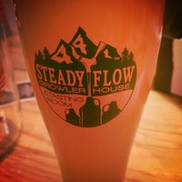 Photo taken at Steady Flow Growler House by Robyn S. on 4/7/2016