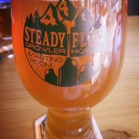 Photo taken at Steady Flow Growler House by Robyn S. on 9/28/2016