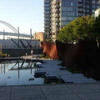 Photo taken at Tanner Springs Park by Kersi A. on 7/15/2014