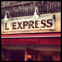Photo taken at L'Express by Naomi on 5/9/2013
