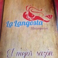 Photo taken at Marisquería La Langosta by Victor M. on 7/18/2014