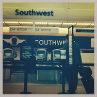 Photo taken at Southwest Ticket Counter by Rebecca E. P. on 10/9/2013
