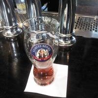 Photo taken at Tigín Irish Pub & Restaurant by Wim V. on 10/17/2015
