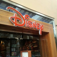 Photo taken at Disney store by Raylene B. on 12/29/2012