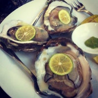 Photo taken at FIVE OYSTERS by Emily C. on 7/13/2013
