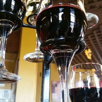 Photo taken at Vinomondo Wine Bar & Brew Pub by Jodi B. on 8/14/2014