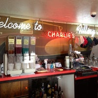 Photo taken at Charlie's Filling Station Lounge by Katie G. on 8/11/2013