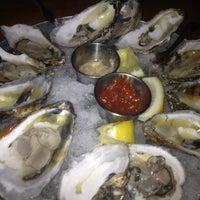 Photo taken at Yoki Japanese Restaurant and Sushi Bar by Tina M. on 10/28/2012